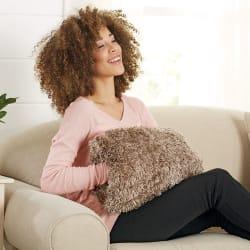 Brookstone Buzzy Mitt Massaging Hand Pillow $13